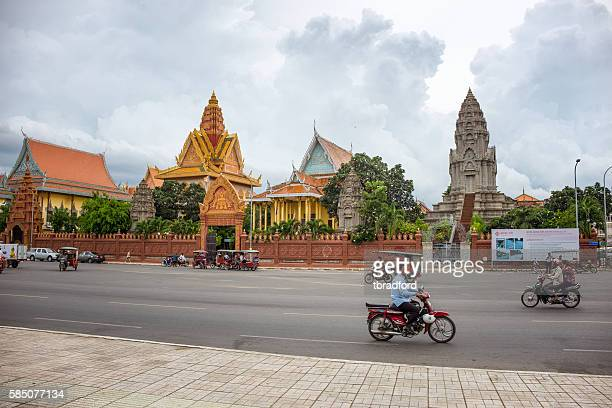 Traffic Outside Wat Ounalom In Phnom Penh, Cambodia