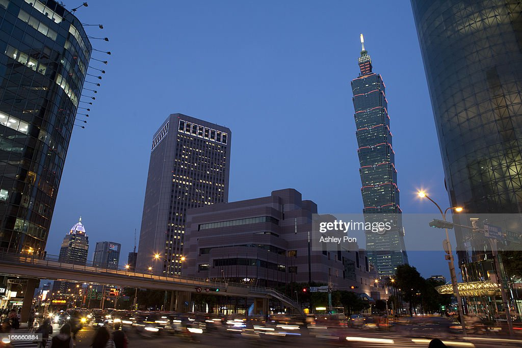 Traffic pass before Taipei 101 building in Taipei's Hsin-yi district on April 15, 2013 in Taipei, Taiwan.