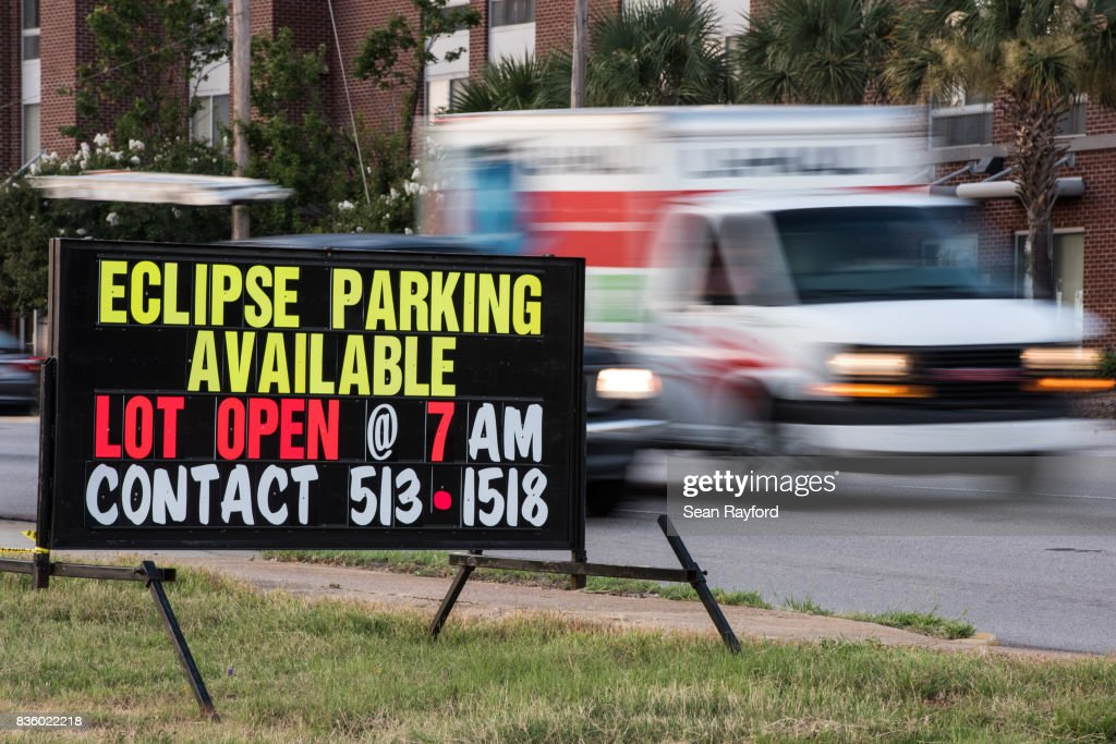 Traffic passes a sign for eclipse parking August 20, 2017 in Columbia, South Carolina. Columbia is one of the prime destinations for viewing Monday's solar eclipse, and NASA expects clear weather to bring over a million visitors to the state.