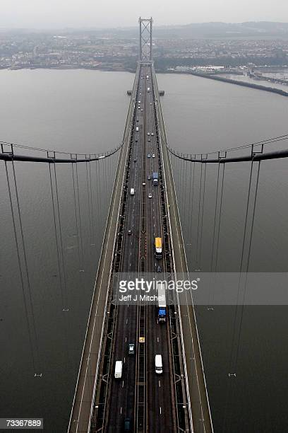 Traffic passes across the Forth Road Bridge on February 19 2007 Officially opened in 1964 by Queen Elizabeth II the suspension bridge spans the Firth...
