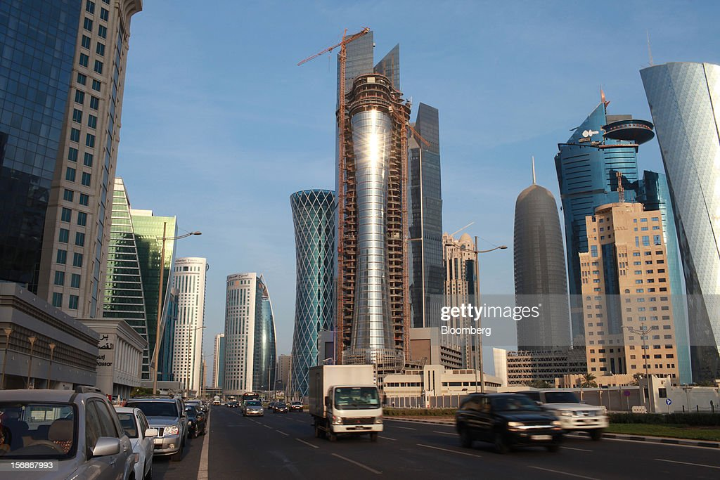 Traffic passes along a highway beside new high-rise buildings under construction in Doha, Qatar, on Thursday, Nov. 22, 2012. Qatar Telecom QSC, the country's biggest company by revenue, is seeking a syndicated loan for about $1 billion to refinance existing debt, according to a person with direct knowledge of the deal. Photographer: Gabriela Maj/Bloomberg via Getty Images