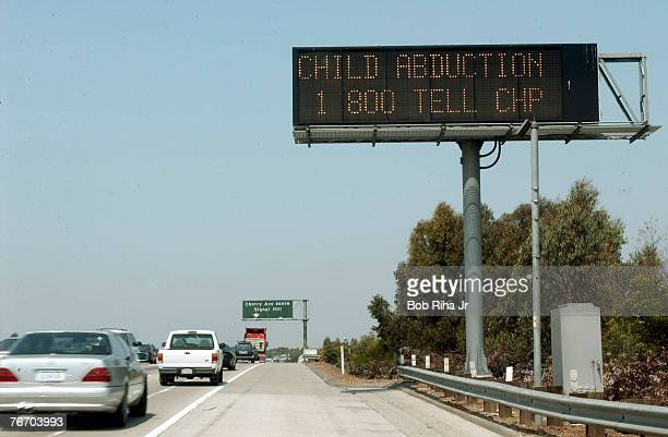 Traffic passes an automated sign on the San Diego Freeway in Long Beach California asking motorists to be on the lookout for a white Ford Bronco...