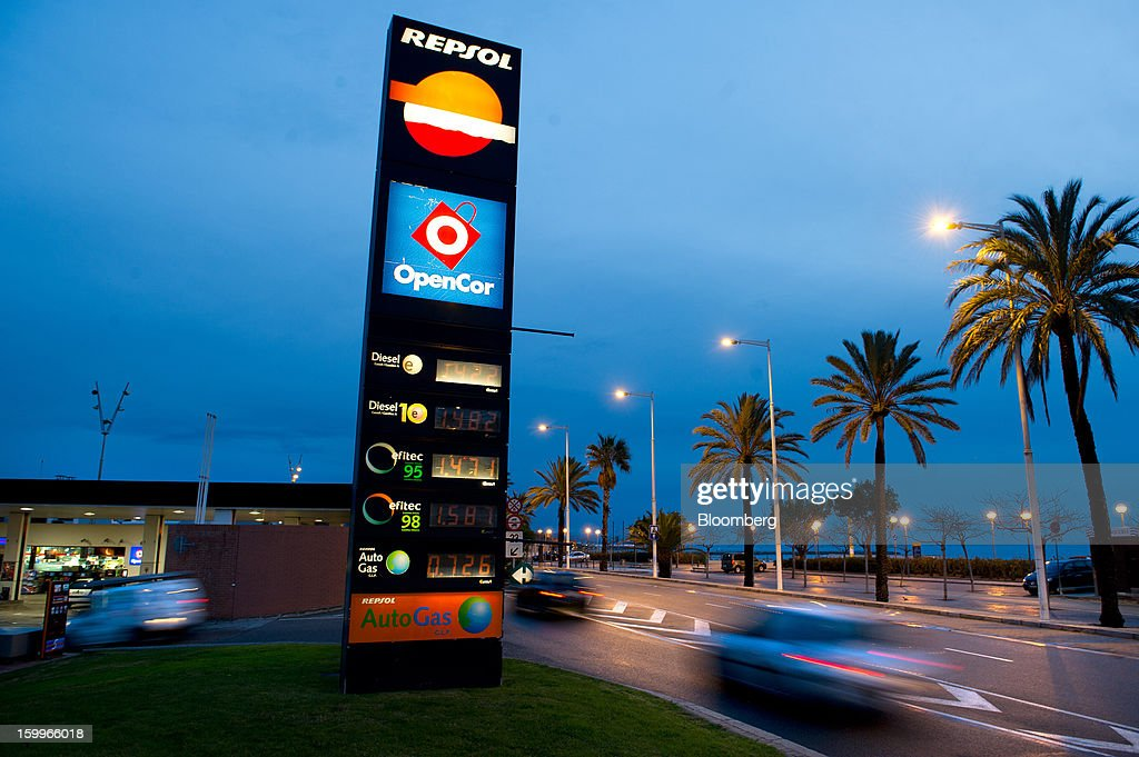 Traffic passes an illuminated sign displaying diesel fuel prices outside a Repsol SA gas station near La Marbella beach in Barcelona, Spain, on Wednesday, Jan. 23, 2013. Repsol SA, Spain's largest energy company, expects to sell liquefied natural gas assets for about 2 billion euros ($2.7 billion) by early February, according to a person familiar with the matter. Photographer: David Ramos/Bloomberg via Getty Images