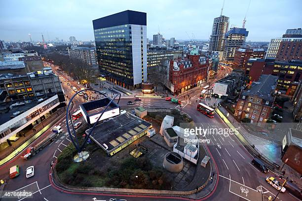 Traffic passes around the Old Street roundabout in the area known as London's Tech City in London UK on Tuesday Dec 17 2013 The UK government last...