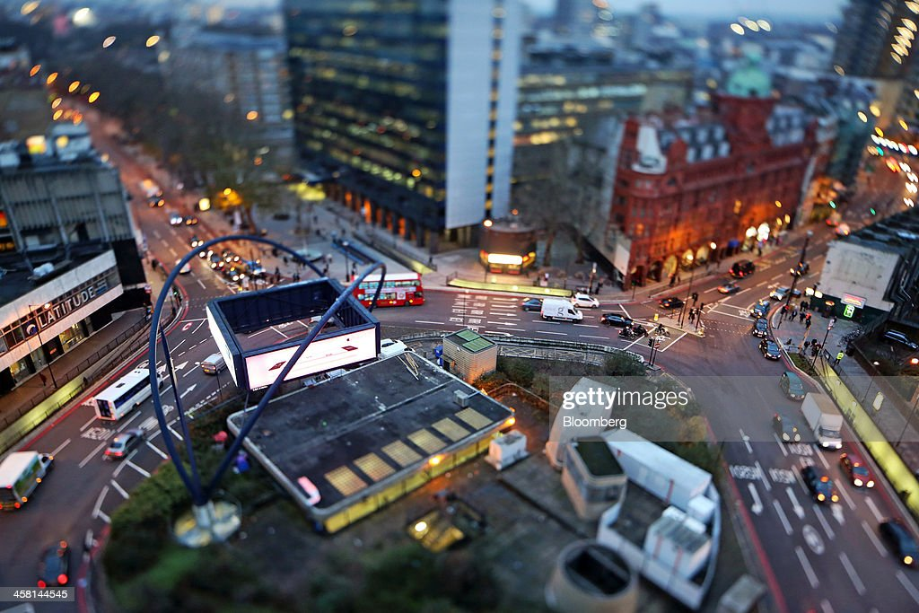 Traffic passes around the Old Street roundabout, in the area known as London's Tech City, in this image taken with a tilt-shift lens in London, U.K., on Tuesday, Dec. 17, 2013. The U.K government last year pledged 50 million pounds for a new London startup incubator, and hired ex-Facebook Inc. executive Joanna Shields to promote Tech City, with Google Inc., Amazon.com Inc., and Cisco Systems Inc. all having taken space in the area or planning to do so. Photographer: Chris Ratcliffe/Bloomberg via Getty Images