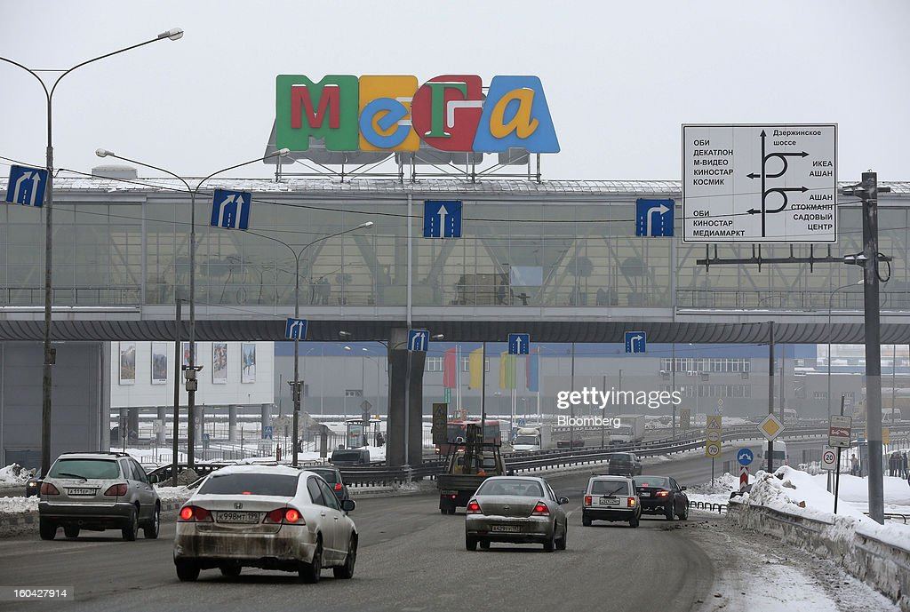 Traffic passes beneath a pedestrian walkway at the MEGA Belaya Dacha shopping complex, constructed by the real estate development arm of Inter Ikea Systems BV and one of Europe's largest malls, in Moscow, Russia, on Thursday, Jan. 31, 2013. Russian shopping-mall construction may climb to a record this year as retailers take advantage of rising sales by moving into bigger, more modern buildings, Cushman & Wakefield Inc. said. Photographer: Andrey Rudakov/Bloomberg via Getty Images