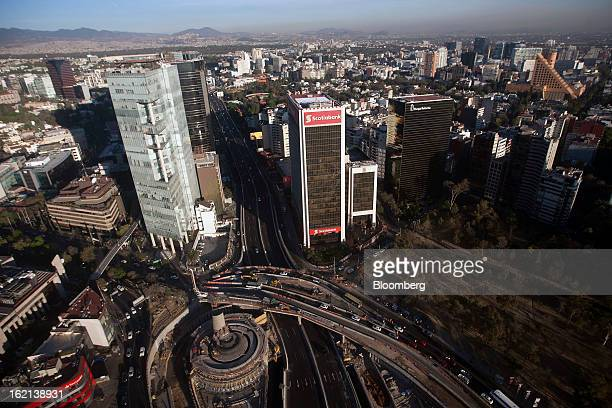 Traffic passes by the Petroleos Fountain foreground near the Soctiabank center and Parque Reforma right office buildings in this aerial photograph...