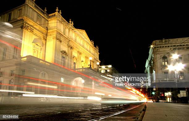 Traffic passes by the road in front of La Scala opera building downtown Milan 16 March 2005 The orchestra and personnel of La Scala demanded...