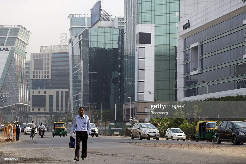 Traffic passes DLF Cybercity, a 128 acre integrated business district, in Gurgaon, India, on Wednesday, March 26, 2014. Indian stocks rose, sending the benchmark index to a record, after the rupee rose to an eight-month high and sovereign bonds gained on speculation the worlds largest democracy will elect a government capable of reviving economic growth. Photographer: Kuni Takahashi/Bloomberg via Getty Images