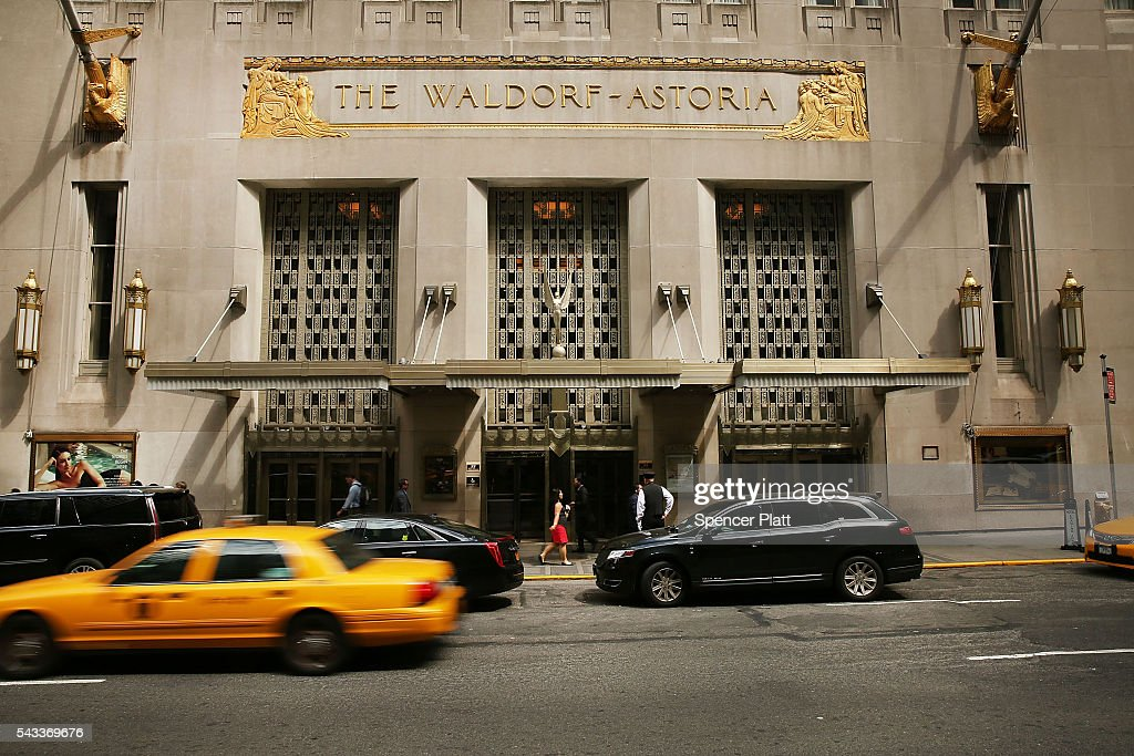 Traffic passes New York's landmark Waldorf Astoria Hotel on June 27, 2016 in New York City. China's Anbang Insurance Group, which recently purchased the Waldorf from Hilton Worldwide Holdings in 2014 for $1.95 billion, has announced plans to convert as much as three-quarters of the rooms into apartments. The insurer will close the Waldorf for up to three years starting next spring for the renovation.