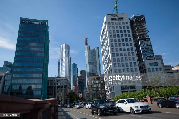 Traffic passes over a bridge as skyscrapers stand beyond in Frankfurt Germany on Thursday July 20 2017 Frankfurt has emerged as a winner of the...