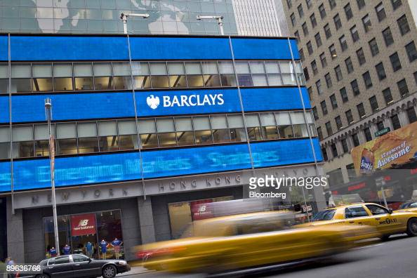 Traffic passes the Barclays PLC office in New York US on Friday June 12 2009 BlackRock Inc agreed to buy Barclays's investment unit for $135 billion...