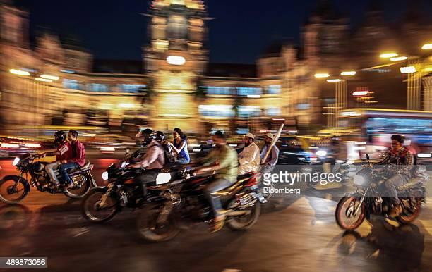 Traffic passes the Chhatrapati Shivaji Terminus railway station in Mumbai India on Wednesday April 15 2015 India's economic growth will power past...