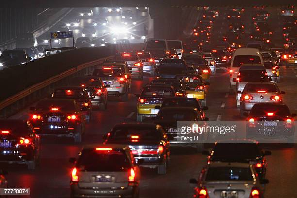 Traffic passes the highway beside the Beijing Olympic National stadium on November 5 2007 in Beijing China The 2008 Olympics host city will introduce...