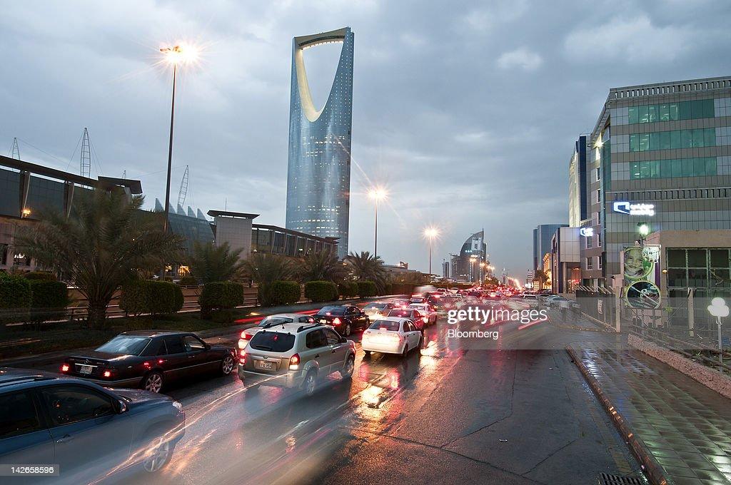 Traffic passes the Kingdom Tower left on King Fahad Road in Riyadh Saudi Arabia on Monday April 9 2012 Saudi Arabia's gross domestic product expanded...