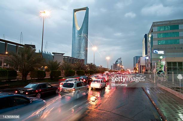 Traffic passes the Kingdom Tower left on King Fahad Road in Riyadh Saudi Arabia on Monday April 9 2012 Saudi Arabia's gross domestic product expanded...