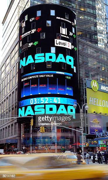 Traffic passes the NASDAQ market site is February 25 2004 in New York City The NASDAQ gained 1754 to close at 202298