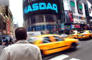 Traffic passes the Nasdaq marketsite October 23 2002 in New York City The Nasdaq composite index fell 227 or 02 percent to 129053 as of Wednesday...
