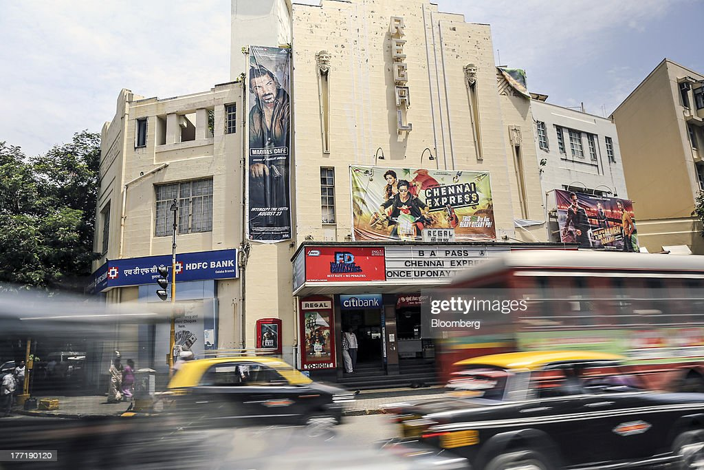 Traffic passes the Regal Cinema in the Colaba area of Mumbai, India, on Wednesday, Aug. 21, 2013. The prospect of an indecisive 2014 election in India is eroding confidence among global investors that the government can stop the rupees worst drop in more than two decades. Photographer: Dhiraj Singh/Bloomberg via Getty Images