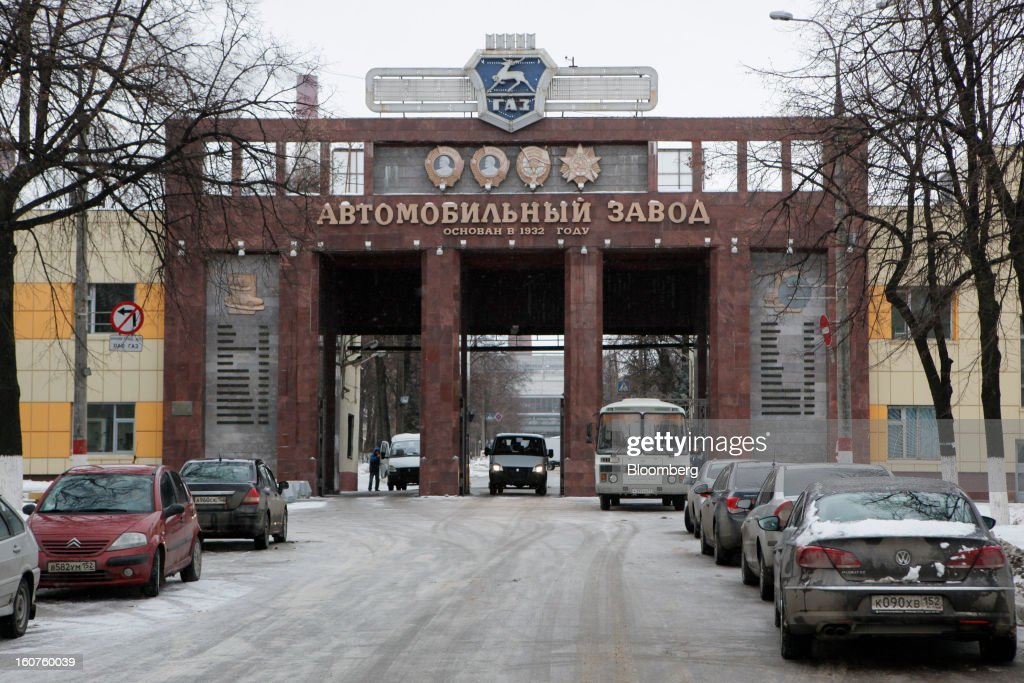 Traffic passes through the entrance to the GAZ Group automobile plant in Niznhy Novgorod, Russia, on Tuesday, Feb. 5, 2013. GAZ, which is controlled by Russian billionaire Oleg Deripaska, plans to make 30,000 Aveo sedans and hatchbacks a year at its plant in Nizhny Novgorod starting in mid-2012. Photographer: Alexander Zemlianichenko Jr./Bloomberg via Getty Images