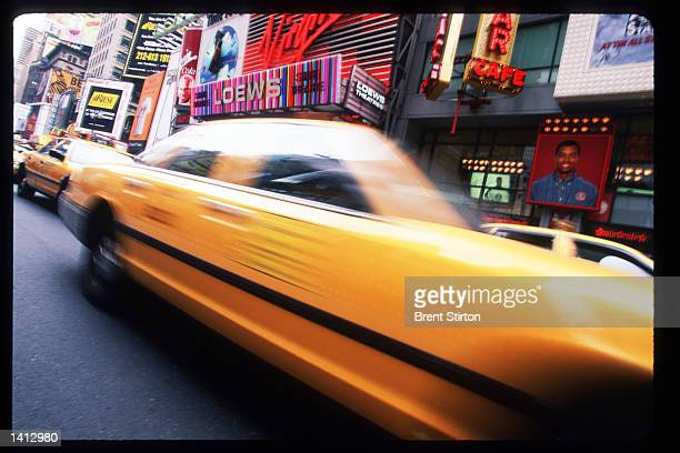 Traffic passes through Times Square November 15 1999 in New York City The Times Square area is undergoing a thorough revitalization prior to hosting...