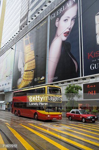Traffic passing billboards of Sogo department store, Causeway Bay, Hong Kong, China : Stock Photo