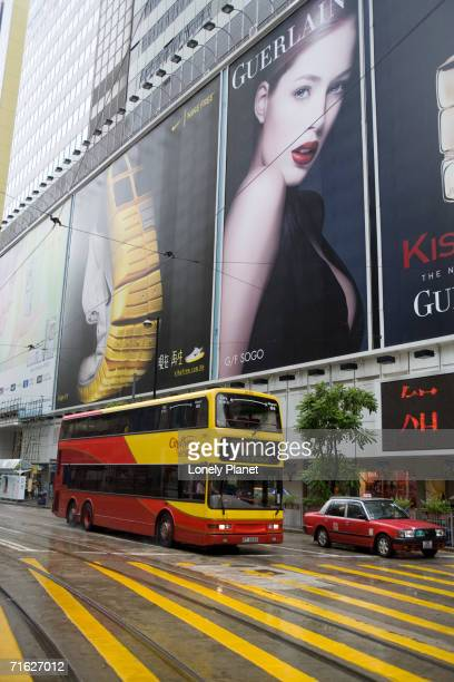 Traffic passing billboards of Sogo department store, Causeway Bay, Hong Kong, China