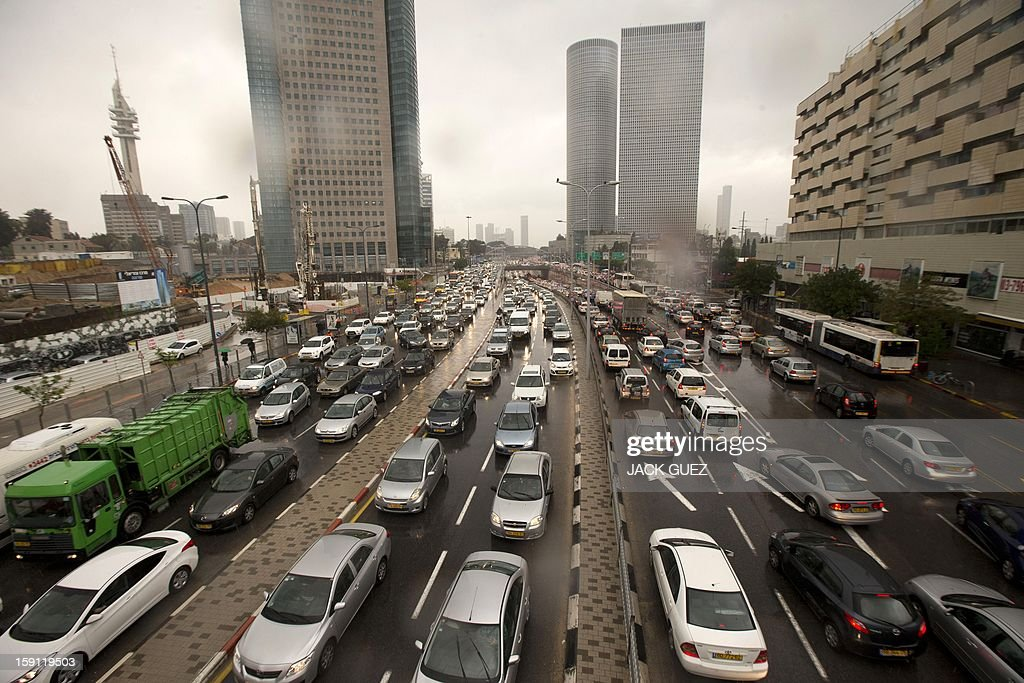 Traffic piles up along a highway as rain storms disrupt the roads and rail system on January 8, 2013, in the Mediterranean coastal city of Tel Aviv. AFP PHOTO/JACK GUEZ