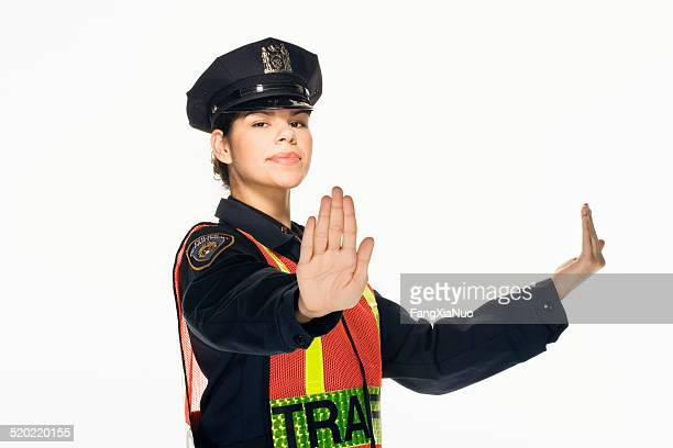 Traffic police officer directing traffic on white background, po