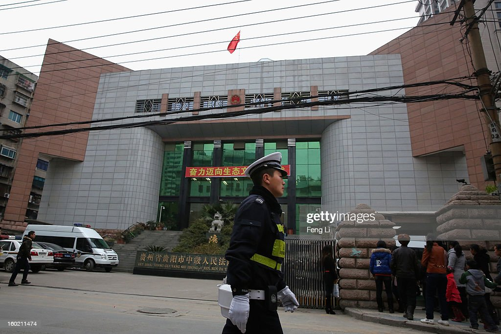 A traffic policeman guards outside Guiyang Intermediate People's Court before a press conference on former Chinese leader Bo Xilai's case on January 28, 2013 in Guiyang, China. 'It is fake information. The trial of Bo Xilai will not open in Guiyang today', Vice-president of Guiyang Intermediate People's Court Jiang Hao said. The trial of Bo Xilai is expected to open after the 'two sessions' in March, China's official newspaper Global Times reports on Monday.