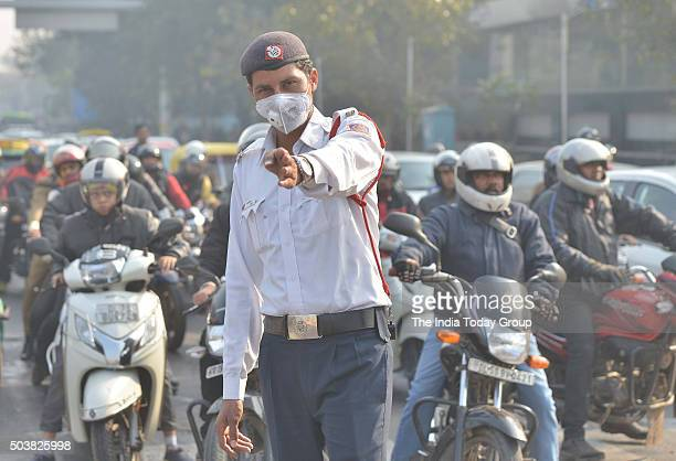 A traffic policeman takes protection against pollution in New Delhi