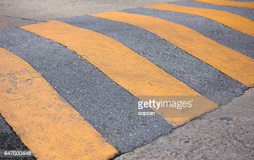 traffic safety speed bump on the road : Stock Photo