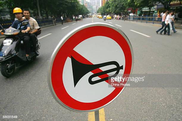 A traffic sign is placed to ban vehicle horns near a middle school where the National College Entrance Examination is held on June 7 2005 in...