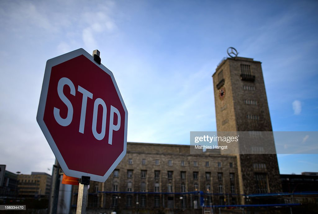 A traffic sign is seen near the construction site of the Stuttgart 21 railway station on December 13, 2012 in Stuttgart, Germany. German state rail carrier Deutsche Bahn, which is carrying out the massive project, announced yesterday that final costs will be EUR 1.1 billion more than previously expected, bringing the total cost to EUR 5.6 billion. The project will replace the current overground, terminal station with a more efficient underground one. Critics have decried the project as too expensive and too environmentally risky.