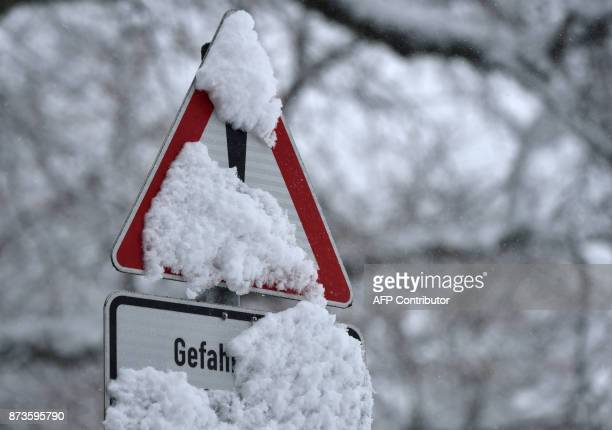 A traffic sign is snowed near the village Marktoberdorf southern Germany after a first onset of winter in Bavaria with temperatures by the freezing...