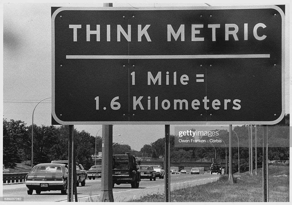 a traffic sign near the us border in quebec reads 39 think metric 1 pictures getty images. Black Bedroom Furniture Sets. Home Design Ideas