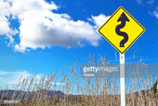 Traffic sign over dry grass : Stock Photo