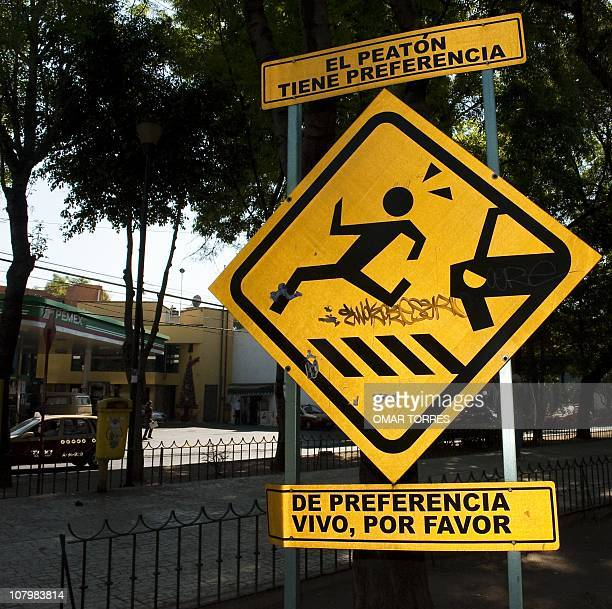 A traffic sign reading 'the pedestrian has priority preferably alive please' in Mexico city on January 05 2011 AFP PHOTO/OMAR TORRES