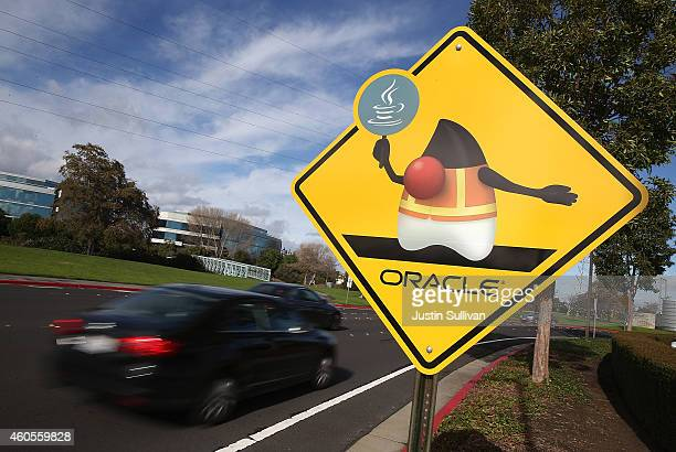 A traffic sign with the Oracle logo is displayed outside of the Oracle headquarters on December 16 2014 in Redwood City California Oracle will report...