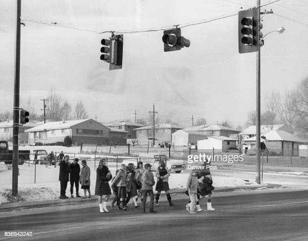 Traffic Signals Guard School Crossing As promised by Denver Traffic Engineer Jack Bruce pedestrial traffic signals have been installed on W 1st Ave...