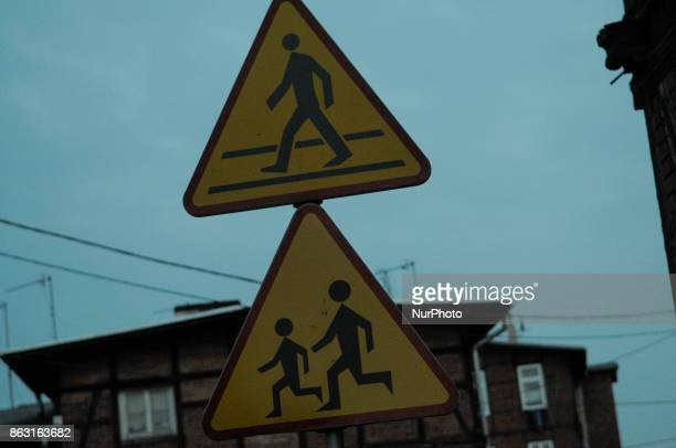 Traffic signs for a children's crossing are seen on 19 October 2017