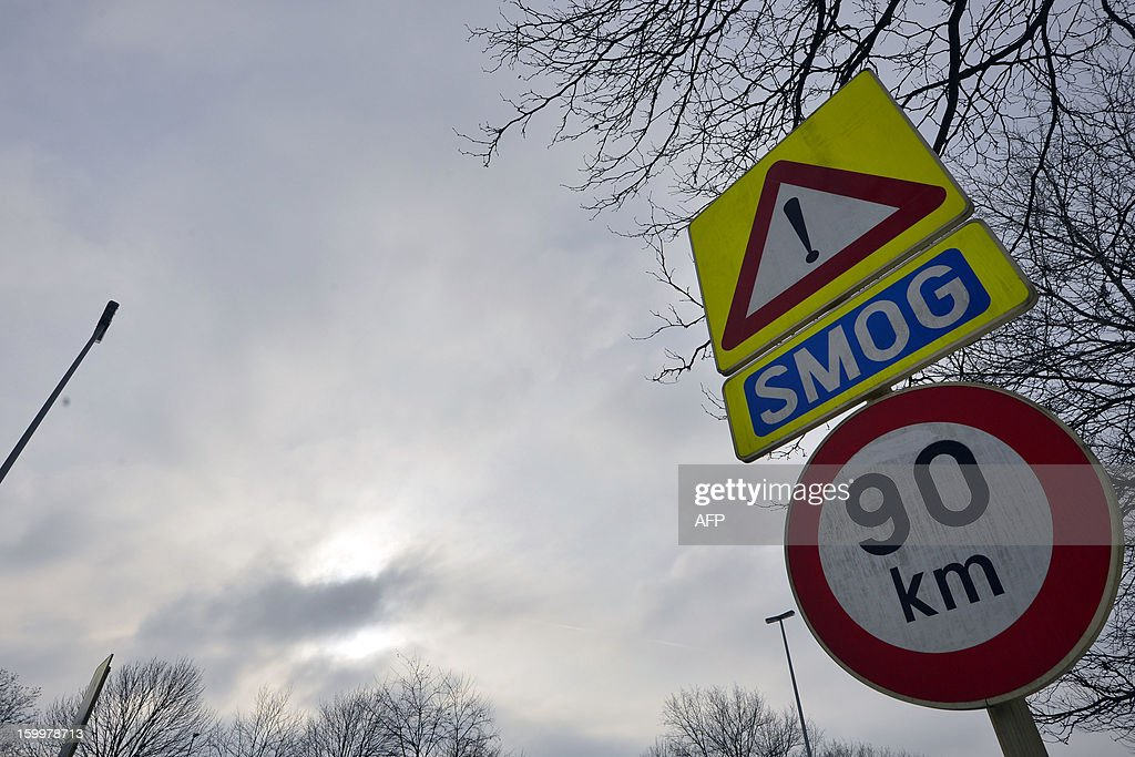 Traffic signs show a warning as the smog alarm was activated, in Flanders and Brussels, on January 24, 2013. The percentage of polluting fine particles in the air has reached an alarm level, and a speed limit is installed to reduce the air pollution. WAEM