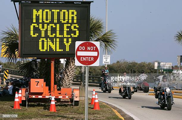 Traffic signs warn car and truck traffic that motorcyclists rule Main Street during the first three days of Bike Week March 3 2006 in Daytona Beach...