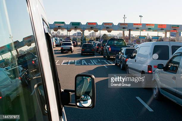 Traffic slowly moving through a toll plaza