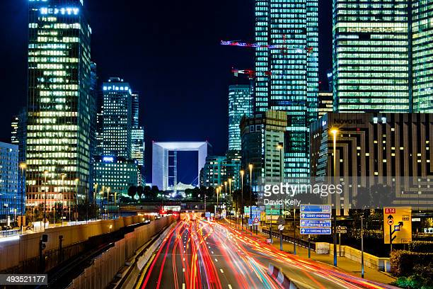 CONTENT] Traffic speeds by La Defense's skyscrapers leaving red lights trails as they seem to head under the Grande Arche