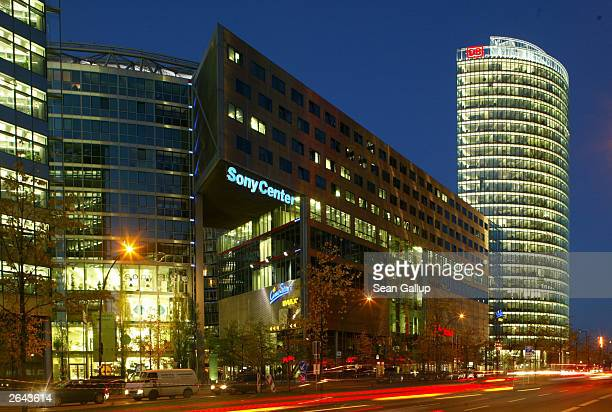 Traffic streaks past buildings including the Sony Center and the Sony Office Tower October 24 2003 at Potsdamer Platz in Berlin Germany Potsdamer...