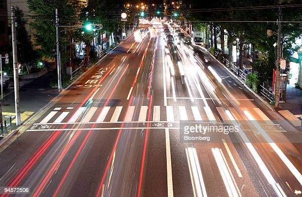 Traffic streams down a street at night in Tokyo Japan on Monday Nov 5 2007 Japan's economy faces increasing risks of slowing amid concern that a US...