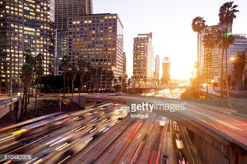 traffic through urban with sunset in los angle
