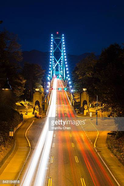 Traffic traveling over the Lions Gate Bridge at night