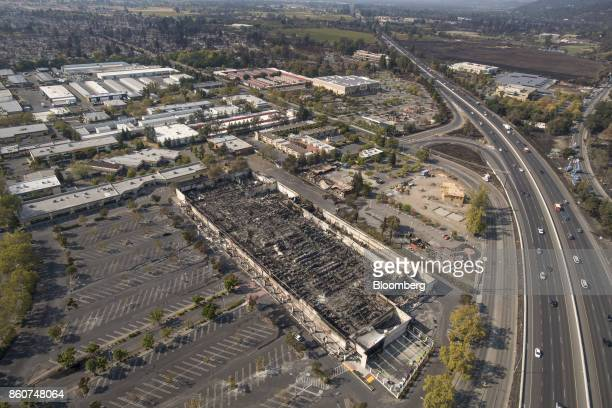 Traffic travelling along a highway near a Kmart discount store burned by wildfires is seen in this aerial photograph taken above Santa Rosa...